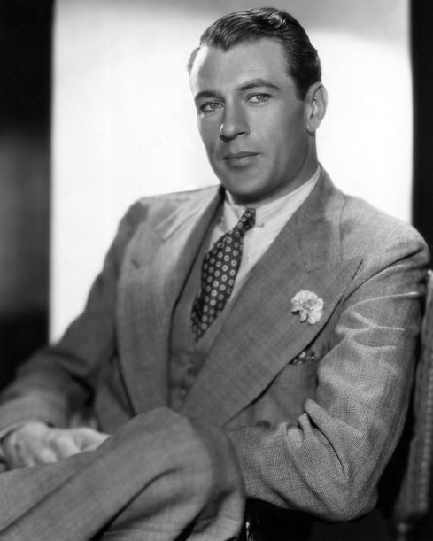 Gary-Cooper-in-a-piece-suit-in-grey-with-mini-carnation-boutonniere-721x900.jpg